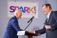 Democratic presidential candidate Joe Biden (left) shakes hands with Dallas Mayor Mike Rawlings as he is introduced to speak to participants in the Dallas Mayor's Intern Fellows Program as during a campaign event at SPARK! on Wednesday, May 29, 2019, in Dallas.(Smiley N. Pool/Staff Photographer)