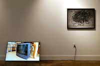 "Artist Penelope Umbrico's piece <i>Pirouette for CRT</i> (left), a 2012, Single channel digital video, color 5 seconds, looped Ed of 10 leans against wall next to <i>36"" used Electrical Cords (eBay)</i>, 2014 Chromogenic Print in the Dallas Medianale show at The MAC gallery in Dallas May 23, 2019.(Tom Fox/Staff Photographer)"