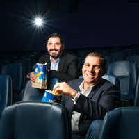 Andy Mitchell (front) and Milos Brajovic, co-presidents of Dallas-based Lantern Entertainment, posed for a portrait at the Highland Park Village Theater.(Smiley N. Pool/Staff Photographer)