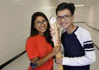 Fatima Roque, left, and Tri Truong pose with the ceremonial mace during rehearsal for their Townview Cemter School of Health Professions graduation at the Alfred J. Loos Sports Complex in Addison, TX, on May 30, 2019.The two 17-year-old students were both named valedictorian of their class, a first for Dallas ISD in at least 20 years. (Jason Janik/Special Contributor)(Jason Janik/Special Contributor)