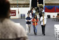 Co-valedictorians, 17-year-old Tri Truong, left, and 17-year-old Fatima Roque, center, rehearse their Townview School of Health Professions graduation entrance at the Alfred J. Loos Sports Complex in Addison, TX, on May 30, 2019. They are joined by Sorrells Education and Human Services Magnet valedictorian, 17-year-old Eddy Pineda, right, (Jason Janik/Special Contributor)(Jason Janik/Special Contributor)