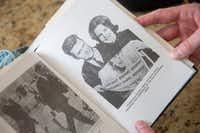 At Eamon Kennedy's home in Plano, the former <i>Dallas Times Herald</i> photographer showed a picture of himself with Kathey Atkinson from Atkinson's 1999 book, <i>Grief of a Nation: Kathey's Story</i>.(Shaban Athuman/Staff Photographer)