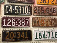 State Rep. Joe Pickett, D-El Paso, has nearly 160 vintage Texas license plates on the walls of his new Texas Capitol office.(Robert T. Garrett/Staff Photographer)