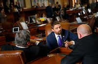 Rep. Jeff Leach, R-Plano, visits with Reps. Jonathan Stickland, R-Bedford, and Tony Tinderholt, R-Arlington, in the Texas House.(Tom Fox/Staff Photographer)