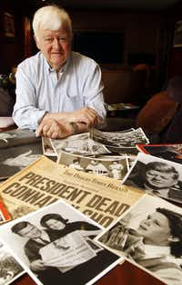 Former Dallas Times Herald photographer Eamon Kennedy with some of his JFK photographs in a photo taken on May 31, 2013. <br>(Michael Ainsworth/Staff Photographer)