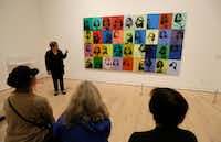 "<p><span style=""font-size: 1em; background-color: transparent;"">Donna De Salvo, senior curator at New York's Whitney Museum of American Art, talks about the piece </span><i style=""font-size: 1em; background-color: transparent;"">Ethel Scull 36 Times&nbsp;</i><span style=""font-size: 1em; background-color: transparent;""> in San Francisco. The&nbsp;</span><span style=""font-size: 1em; background-color: transparent;"">brightly colored montage of images anticipated modern-day selfies and Instagram posts.</span><br></p>(Eric Risberg/The Associated Press)"