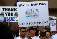 Dallas police and fire retirees hold signs during a rally against Mayor Mike Rawlings at City Hall on April 26, 2017.(File Photo/Staff)