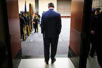 Dallas Mayor Mike Rawlings waits in a doorway for the Dallas Police memorial service, honoring officers who lost their lives in the line of duty, to begin at the Kay Bailey Hutchison Convention Center on May 8, 2019. (Smiley N. Pool/The Dallas Morning News)(Smiley N. Pool/Staff Photographer)