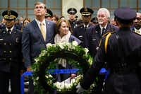 Dallas Mayor Mike Rawlings stands with wife Micki behind a wreath during the Dallas Police memorial service, honoring officers who lost their lives in the line of duty,  at the Kay Bailey Hutchison Convention Center on May 8, 2019. (Smiley N. Pool/The Dallas Morning News)