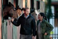 Britain's Prince Harry and Meghan Markle, duchess of Sussex, walk together during a visit to the Moroccan Royal Equestrian Sports Complex in Rabat, Morocco, in February.(Mosa'ab Elshamy/The Associated Press)