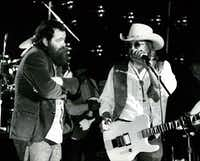 Roky Erickson (left) joins Doug Sahm and the Texas Tornados onstage in March 1991 during the Austin Music Awards.(1991 File Photo)