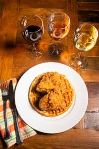 Chicken and waffles with wine photographed during a wine panel in Dallas(Shaban Athuman/Staff Photographer)