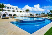 "Relax poolside at Cuisinart Golf Resort and Spa, or head to Anguilla's fabulous white-sand beaches.&nbsp;(<p><span style=""font-size: 1em; background-color: transparent;"">Envisionworks Inc.</span></p>/<p><span style=""font-size: 1em; background-color: transparent;"">Cuisinart Golf Resort and Spa</span></p>)"