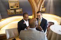 Mayoral candidates Eric Johnson and Scott Griggs chats with a member of the Dallas Citizen Council after their debate at The Crescent Club in Dallas on Tuesday, May 28, 2019. (Shaban Athuman/Staff Photographer)