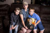 Becky Welch poses with her sons Aaden Welch, 11, left, and Robby Welch, 9, with a portrait of Army 1st Lt. Robert Welch, in their Wylie, Texas home Friday, May 31, 2019.(Shaban Athuman/Staff Photographer)