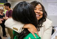 Lavinia Masters hugs Rep. Victoria Neave after Governor Greg Abbott signed House Bill 8 during a bill signing ceremony at New Friends New Life on Tuesday, June 4, 2019, in Dallas. House Bill 8 is named after Masters, Ša Dallas survivor whose rape kit sat on a shelf Šfor more than 21 years Šafter she was raped at knifepoint in her home when she was 13. The Governor signed legislation related to human trafficking and the elimination of the rape kit backlog. (Smiley N. Pool/Staff Photographer)