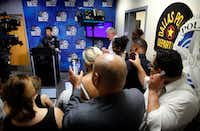 Deputy Mayor Pro Tem Adam Medrano (center, back to camera) and council member Omar Narvaez (right, front) record and stream Dallas Police Chief U. Renee Hall's news conference pertaining to the death of Chynal Lindsey, a black transgender woman found dead.(Tom Fox/Staff Photographer)