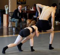 "<p><span style=""font-size: 1em; background-color: transparent;"">Garrett Smith watches as Bruce Wood Dance company members Lauren Hibbard and Seth York rehearse his new piece </span><em style=""font-size: 1em;"">Forbidden Paths</em><span style=""font-size: 1em; background-color: transparent;"">, which premieres when the company opens its season June 14-15. The work is based on the choreographer's reaction to restrictions placed on women in Iran that discourages them from dancing in public and on social media.</span></p>(Lawrence Jenkins/Special Contributor)"