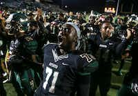 Leroy Hawkins celebrates after the Eagles' 40-21 win over Mansfield Summit at Eagle Stadium on Oct. 26. Hawkins was shot and killed while sitting in a car in downtown Dallas.(Ryan Michalesko/Staff Photographer)