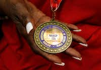 Detail of a medal Daisy Garner received from the NAACP for her husband Willie B. Ludden Jr. during his memorial service at Evergreen Memorial Funeral Home in Dallas on Tuesday(Vernon Bryant/Staff Photographer)