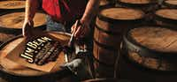 A Jim Beam worker paints the tops of barrels. The company offers tours to the public at Jim Beam American Stillhouse in Clermont, Ky.(Jim Beam/Courtesy)