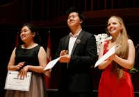 <p>From left: JiWon Yang, 17, of South Korea; Shuan Hern Lee, 16, of Australia; and Eva Gevorgyan, 15, of Russia and Armenia, stand on stage after being named finalists for the 2019 Cliburn International Junior Piano Competition and Festival at Caruth Auditorium in Dallas on June 6, 2019.</p>(Vernon Bryant/Staff Photographer)