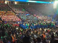 Sam's Club employees stand up and cheer when anyone making presentations mentions the store. It's a longtime tradition at Walmart's annual meeting/celebration.(Maria Halkias/Dallas Morning News)