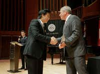 Shuan Hern Lee from Australia receives congratulations from Cliburn President and CEO Jacques Marquis after being selected as a finalist of the Cliburn International Junior Piano Competition and Festival at Caruth Auditorium on the campus of SMU in Dallas.(Ralph Lauer/Cliburn Foundation)