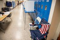 A chair featuring an American flag pattern sits at the John F. Peeler Elementary School, precinct 4070, polling station in Oak Cliff on Saturday. In Dallas County, more votes were cast during early voting than on Election Day. <br>(Shaban Athuman/Staff Photographer)