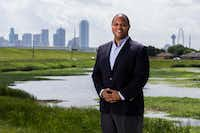 State Rep. and Dallas mayoral candidate Eric Johnson poses for a photo in the former Los Altos neighborhood where he grew up on Thursday, May 23, 2019 in West Dallas. Johnson said he would play in the grass pictured behind him and he and his friends would swing on a swing set that overlooked the Dallas skyline. He lived in an apartment complex that was torn down many years ago. (Ashley Landis/Staff Photographer)