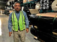 Alexander Sierra, plant manager at ACME mills, walks through his distribution warehouse June 5 in Santa Teresa, N.M., on the border with Texas. He worries about possible tariffs proposed by President Donald Trump.(Alfredo Corchado/The Dallas Morning News)