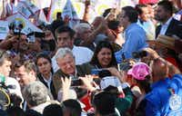 Mexican President Andres Manuel Lopez Obrador shakes hands with supporters during a unity rally on June 8 in Tijuana, Mexico.. Lopez Obrador committed to defending Mexico's dignity amid a looming threat from U.S. President Donald Trump, who has pledged to impose 5% tariffs on Mexican products unless the country prevents Central American migrants from traveling through its territory.(Sandy Huffaker/Getty Images)