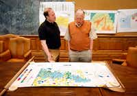 <p>Dallas Morning News reporter Alan Peppard (left) pores over an oil and gas map with T. Boone Pickens in the boardroom on Pickens' Mesa Vista Ranch in the panhandle of Texas near the town of Miami.</p>(Tom Fox/Staff Photographer)
