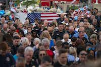 "Attendees bow their heads during a vigil Sunday for Grand Prairie police Officer Albert ""A.J."" Castaneda at the Grand Prairie Public Safety Building.(Shaban Athuman/Staff Photographer)"