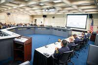 Members of the Dallas Police Department give a presentation during a Public Safety and Criminal Justice Committee briefing.(Shaban Athuman/Staff Photographer)