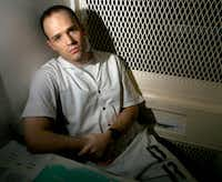 "In this Dec. 3, 2003, file photo, Texas death row inmate Randy Halprin, then 26, sat in a visitation cell at the Polunsky Unit in Livingston. Halprin, a Jewish death row inmate who was part of the ""Texas 7"" gang of escaped prisoners, has filed an appeal claiming former District Judge Vickers Cunningham was anti-Semitic and frequently used racial slurs. Halprin argues that Cunningham should've recused himself. (File Photo/The Associated Press)"