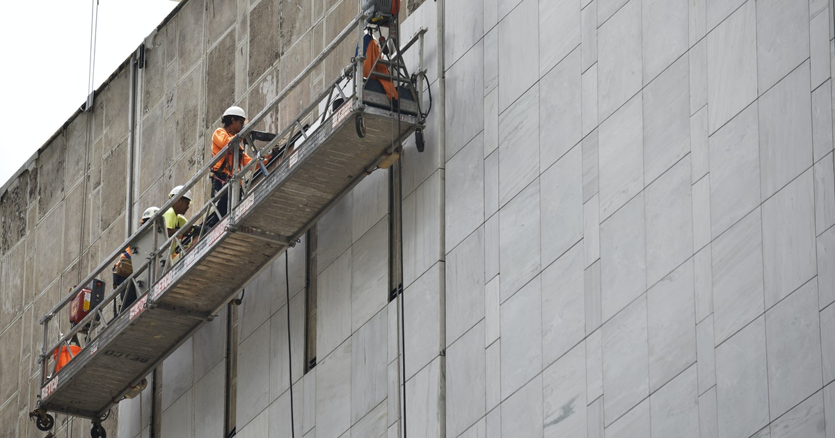 Downtown Dallas' landmark First National Bank tower is getting its restored marble exterior two...