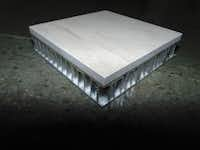HyCOMB USA slices down the original thick marble panels and adheres the thinner stone to a metal honeycomb.(HyCOMB USA)