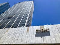 """<p><span style=""""font-size: 1em; background-color: transparent;"""">Construction workers are reinstalling the marble on the First National Bank buildings in downtown Dallas</span></p>(Steve Brown)"""