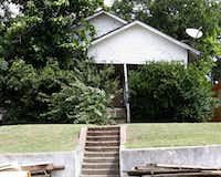 This is the house at 1121 E. Ninth St. that will be demolished, because the Landmark Commission could do nothing to stop the court order.(Irwin Thompson/Staff photographer)