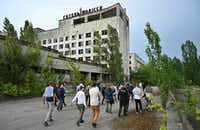 Visitors walk in the ghost city of Pripyat during a tour of the Chernobyl Exclusion Zone. HBO's hugely popular television series <i>Chernobyl&nbsp;</i>has renewed interest in Ukraine's 1986 nuclear disaster.(Genya Savilov&nbsp;/Agence France-Presse/Getty Images)