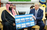 President Donald Trump holds a defense sales chart with Saudi Arabia's Crown Prince Mohammed bin Salman in the Oval Office of the White House in Washington, DC.(2018 File Photo/Agence France-Presse)