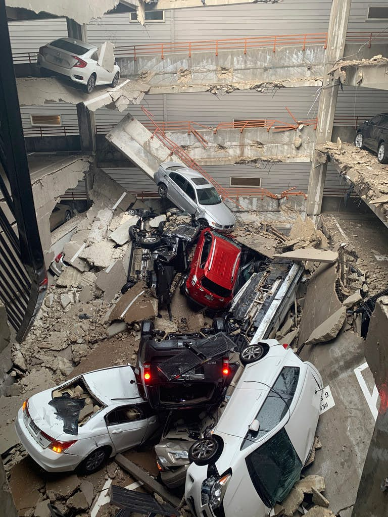 One death and several injuries were reported after a crane fell into the Elan City Lights apartment building and parking garage in Old East Dallas close to downtown, as a severe storm passed through Dallas on Sunday afternoon(Brent Raymond)