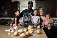 James McGee, owner of the vegan restaurant Peace Love & Eatz in DeSoto, with his family Solstice McGee, 2, left, Captain McGee, 4, wife Morgan McGee and their baby Phoenix.(Ben Torres)