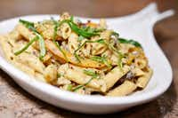 James McGee, owner of Peace Love & Eatz, a vegan restaurant in DeSoto, cooked a vegan pasta with the help of his family.(Ben Torres)
