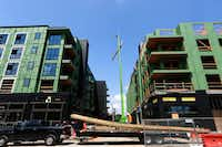 Construction workers were busy last September on the latest apartment complex going up in downtown Plano.(File Photo/Staff )