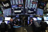 Traders work on the floor of the New York Stock Exchange on June 10.(Spencer Platt/Getty Images)