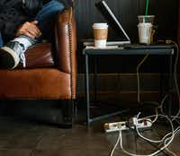 A resident, name withheld for privacy, whose power has yet to be restored since Sunday's rain storm, charges his electronics at a Starbucks coffee shop on Preston Road in Dallas on Tuesday, June 11, 2019. (Lynda M. Gonzalez/Staff Photographer)