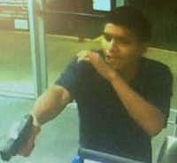 The suspect pointed a gun at the employee behind the counter and emptied the register before fleeing.(Dallas police)