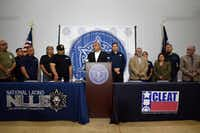 George Aranda, speaking, director of the National Latino Law Enforcement Organization, calls for a vote of no confidence in the leadership of Dallas Chief of Police Renee Hall during a press conference at the headquarters of the National Latino Law Enforcement Organization in Dallas. (Ben Torres/Special Contributor)